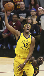 April 29, 2018 - Cleveland, OH, USA - Indiana Pacers' Myles Turner is fouled by Cleveland Cavaliers' Jeff Green during the fourth quarter of Game 7 of the Eastern Conference First Round series on Sunday, April 29, 2018 at Quicken Loans Arena in Cleveland, Ohio. The Cavs won the game, 105-101. (Credit Image: © Phil Masturzo/TNS via ZUMA Wire)