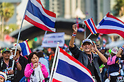"""15 JANUARY 2014 - BANGKOK, THAILAND:  Anti-government protestors gather at the stage in the Asoke intersection for Shutdown Bangkok. Tens of thousands of Thai anti-government protestors continued to block the streets of Bangkok Wednesday to shut down the Thai capitol. The protest, """"Shutdown Bangkok,"""" is expected to last at least a week. Shutdown Bangkok is organized by People's Democratic Reform Committee (PRDC). It's a continuation of protests that started in early November. There have been shootings almost every night at different protests sites around Bangkok. The malls in Bangkok are still open but many other businesses are closed and mass transit is swamped with both protestors and people who had to use mass transit because the roads were blocked.   PHOTO BY JACK KURTZ"""