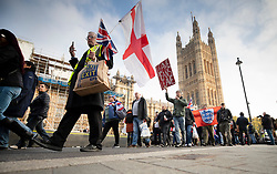 © Licensed to London News Pictures. 31/10/2019. London, UK. Pro-Brexit protestors gather near Parliament on what would have been the United Kingdom's last day as a member of the European Union. The date of Brexit had been moved to January 31, 2020 after MPs failed to pass Prime Minister Boris Johnson's withdrawal agreement. Photo credit: Peter Macdiarmid/LNP