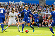 John Stones of Everton is marked by Gylfi Sigurdsson in the first half.<br /> Barclays Premier League match, Swansea city v Everton at the Liberty Stadium in Swansea, South Wales on Saturday 19th September 2015.<br /> pic by Phil Rees, Andrew Orchard sports photography.