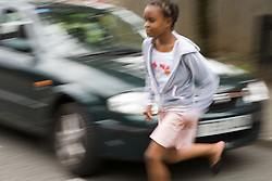Girl running out into the road in front of a moving vehicle,