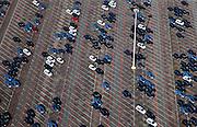Nederland, Limburg, Gemeente Sittard-Geleen, 07-03-2010; parkeerterrein (depot) bij NedCar met nieuwe in born voor door Mitsubishi geproduceerde auto's.Parking (depot) at NedCar with new cars produced for Mitsubishi.luchtfoto (toeslag), aerial photo (additional fee required).foto/photo Siebe Swart