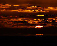 Sun setting over the Pacific Ocean from the deck of the MV World Odyssey. Semester at Sea, 2016 Spring Semester Voyage. Day 2 of 102. Image taken with a Nikon 1 V3 camera and 70-300 mm VR lens (ISO 200, 165 mm, f/16, 1/1000 sec).