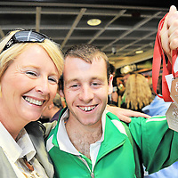 Robbie McNamara, who won a gold and two silver medals the 2010 Special Olympics European Games in Warsaw, with his mother Susan O'Grady when the team arrived in Dublin airport at the week-end.
