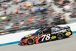 October 7, 2018 - Dover, DE, U.S. - DOVER, DE - OCTOBER 07: Martin Truex Jr drove his #78 5-hour ENERGY/Bass Pro Shops Toyota to a 15th place finish, after a late race incident, in the Gander Outdoors 400 on October 07, 2018, at Dover International Speedway in Dover, DE. (Photo by David Hahn/Icon Sportswire) (Credit Image: © David Hahn/Icon SMI via ZUMA Press)
