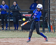Middletown, New York - A Middletown batter hits the ball in a varsity girls' softball game on April 7, 2014.