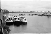 06-10/04/1964.04/06-10/1964.06-10 April 1964.Views on the River Shannon. Three of the Irish River Floatels- fully equipped floating hotels which cruise the Shannon from May to September. Athlone, Co. Westmeath.