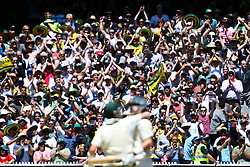 © Licensed to London News Pictures. 29/12/2013. Australian supporters congratulate Shane Watson and Michael Clarke after they scored the winning runs during Day 4 of the Ashes Boxing Day Test Match between Australia Vs England at the MCG on 29 December, 2013 in Melbourne, Australia. Photo credit : Asanka Brendon Ratnayake/LNP