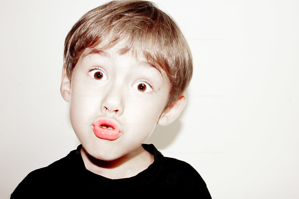 A young boy pulls a funny face.