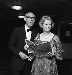 MARGARET THATCHER and DENIS THATCHER at the Conservative Party's Winter Ball at The Grosvenor House Hotel, London on 19th February 1975.