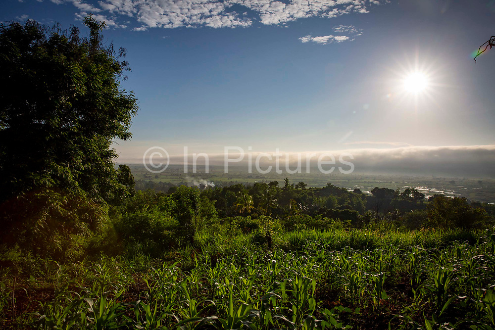 Sunrise and early morning mist over the plains on the 20th November 2019 in Mvomero district, Morogoro region, Tanzania.