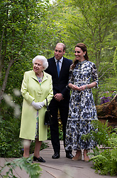 Queen Elizabeth II and the Duke and Duchess of Cambridge during their visit to the RHS Chelsea Flower Show at the Royal Hospital Chelsea, London.