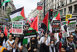 Pro-Palestinian activists join thousands of people attending a United Against The Tories national demonstration organised by the People's Assembly Against Austerity in protest against the policies of Prime Minister Boris Johnson's Conservative government on 26th June 2021 in London, United Kingdom. The demonstration contained blocs from organisations and groups including Palestine Solidarity Campaign, Stand Up To Racism, Stop The War Coalition, Extinction Rebellion, Kill The Bill and Black Lives Matter as well as from trade unions Unite and the CWU.