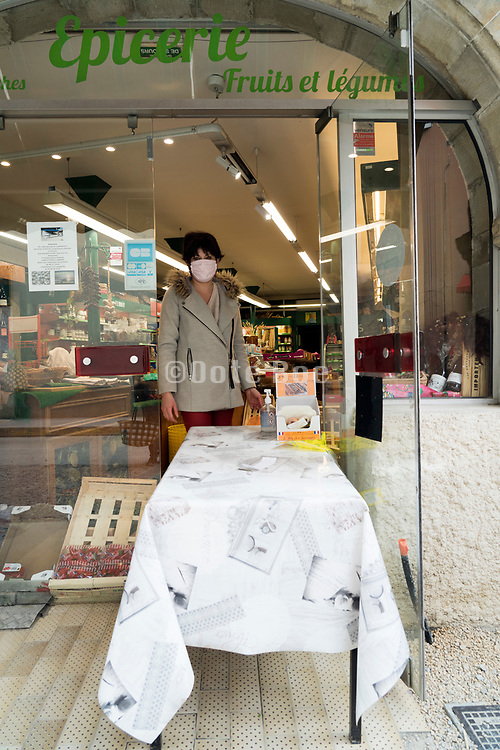 food shop with table in the door opening for social distance protection during the Covid 19 crisis France Limoux April 2020