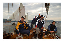 The crew of Solway Maid at the start off Largs in the passage to Helensburgh, with Kentra lying to windward...This the largest gathering of classic yachts designed by William Fife returned to their birth place on the Clyde to participate in the 2nd Fife Regatta. 22 Yachts from around the world participated in the event which honoured the skills of Yacht Designer Wm Fife, and his yard in Fairlie, Scotland...FAO Picture Desk..Marc Turner / PFM Pictures