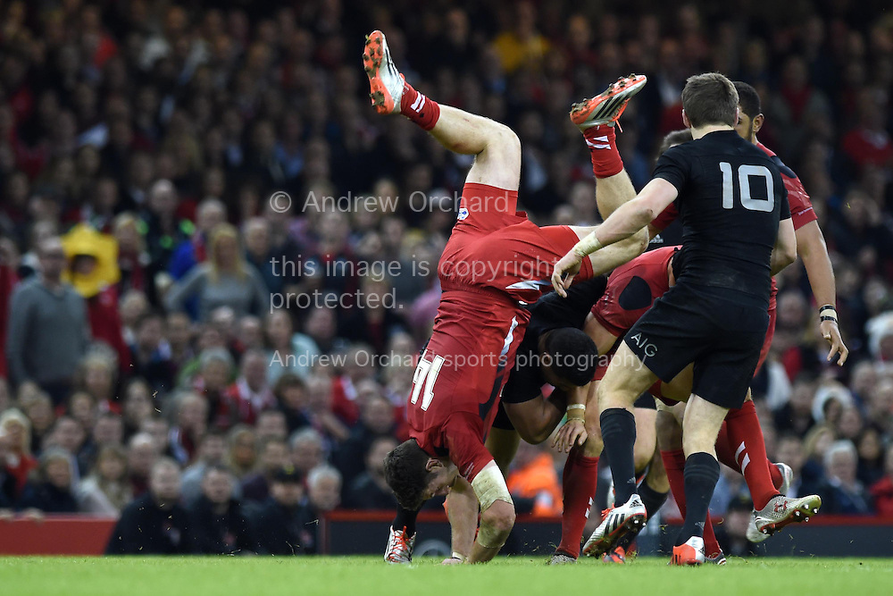 Alex Cuthbert of Wales tumbles over Leigh Halfpenny of Wales as he tries to make a break. Dove Men Series 2014, Wales v New Zealand , autumn international rugby match at the Millennium Stadium in Cardiff, South Wales on Saturday 22nd November 2014<br /> pic by Andrew Orchard, Andrew Orchard sports photography.