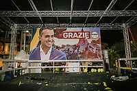 """POMIGLIANO D'ARCO, ITALY - 6 MARCH 2018: The empty stage with a """"Grazie"""" (Thank You) banner of Luigi Di Maio, leader of the Five Star Movement, who returned to his his hometown to celebrate the movement's victory in the 2018 Italian General Elections, is seen here after the event in Pomigliano D'Arco, Italy, on March 6th 2018.<br /> <br /> The Five-Star Movement, became the first party in Italy, with 33 percent of the vote."""