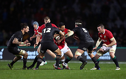 British and Irish Lions' Ben Te'o is tackled by Maori All Blacks' Charlie Ngatai (left) and Thomas Franklin during the Tour match at the Rotorua International Stadium.