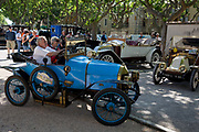 A visiting vintage car in the centre of a French village, during a three-day rally journey through the Corbieres wine region, on 26th May, 2017, in Lagrasse, Languedoc-Rousillon, south of France. Lagrasse is listed as one of Frances most beautiful villages and lies on the famous Route 20 wine route in the Basses-Corbieres region dating to the 13th century.