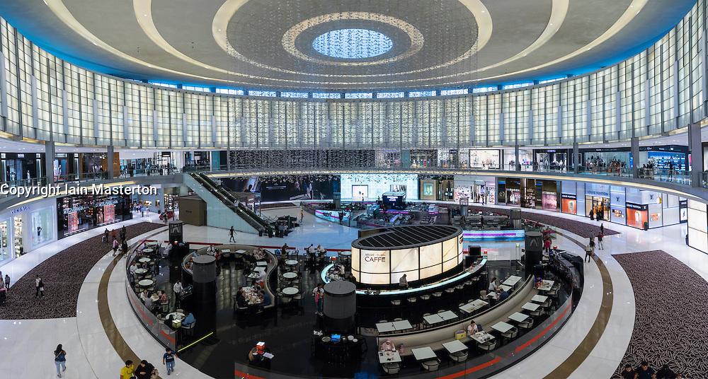 View of Fashion Avenue atrium with cafes and shops within Dubai Mall in Dubai United Arab Emirates