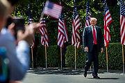 """President Donald Trump smiles at the audience as he arrives during a """"Celebration of America"""" event on the South Lawn of the White House on June 5, 2018 in Washington, DC. The celebration is being staged as a replacement for a White House visit by the Super Bowl champion Philadelphia Eagles. Some of the team was planning on boycotting the event due to the President's stance on players kneeling during the National Anthem at NFL games, so Trump resented their invitation.      Photo by Pete Marovich/UPI"""