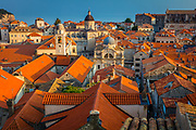 Dubrovnik, Croatia, with its characteristic medieval city walls. Dubrovnik is a Croatian city on the Adriatic Sea, in the region of Dalmatia. It is one of the most prominent tourist destinations in the Mediterranean, a seaport and the center of Dubrovnik-Neretva County. In 1979, the city of Dubrovnik joined the UNESCO list of World Heritage Sites.<br /> <br /> The prosperity of the city was historically based on maritime trade; as the capital of the maritime Republic of Ragusa, it achieved a high level of development, particularly during the 15th and 16th centuries, as it became notable for its wealth and skilled diplomacy.<br /> <br /> A feature of Dubrovnik is its walls that run almost 2 km (1.24 mi) around the city. The walls run from four to six meters (13.2 to 19.8 feet) thick on the landward side but are much thinner on the seaward side. The system of turrets and towers were intended to protect the vulnerable city. The walls of Dubrovnik have also been a popular filming site for the fictional city of King's Landing in the HBO television series, Game of Thrones.