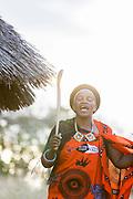 Portrait of Sibongile Fakudze dancing while wearing shawl given to her at last Emaganwini, the Marula Festival, Eswatini