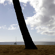 Honolulu, HI, July 17, 2007: The tranquil days of summer at Waimea Bay on the North Shore of Oahu in Hawaii stand in stark contrast to the windy days with enormous waves that have made Waimea Bay world famous . (Photograph by Todd Bigelow/Aurora)