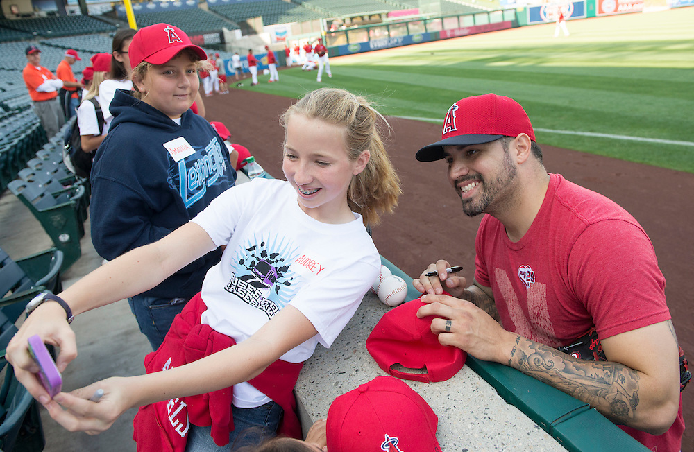 Audrey Chronik, 12, of Orange, snaps a selfie with Angels pitcher Hector Santiago while visiting Angel Stadium Tuesday with First Tee of Orange County, a youth development organization introducing the game of golf and its inherent values to young people.<br /> <br /> ///ADDITIONAL INFO:   <br /> <br /> angels.0615.kjs  ---  Photo by KEVIN SULLIVAN / Orange County Register  -- 6/14/16<br /> <br /> The Los Angeles Angels take on the Minnesota Twins Tuesday at Angel Stadium.