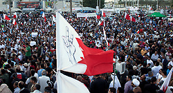 © under license to London News Pictures. 20/02/2011. A Bahriani Flag with peace symbols drawn on it flies over Pearl Rounabout in Manama, Bahrain today (20/02/2011). Photo credit should read Michael Graae/London News Pictures