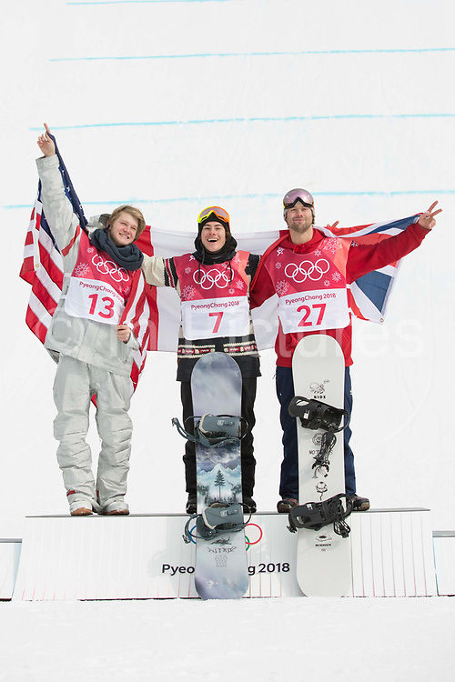 Billy Morgan, Great Britain, BRONZE with Sebastien Toutant, Canada, GOLD and Kyle Mack, USA, SILVER at the mens snowboard big air flower ceremony at the Pyeongchang 2018 Winter Olympics on 24th February 2018, at the Alpensia Ski Jumping Centre in Pyeongchang-gun, South Korea