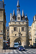 Mini Cooper car at Porte Cailhau 15th century entrance to city of Bordeaux marks victory of Charles VIII at Fornoue