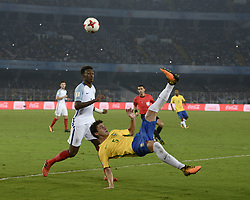 October 25, 2017 - Kolkata, West Bengal, India - Brazil Victor Bobsin (jersey 5) and England Callum Hudson-Odoi (jersey 14)  in action during the FIFA U 17 World Cup India 2017 Semi Final match in Kolkata. Players of England and Brazil in action during the FIFA U 17 World Cup India 2017 Semi Final match on October 25, 2017 in Kolkata. (Credit Image: © Saikat Paul/Pacific Press via ZUMA Wire)