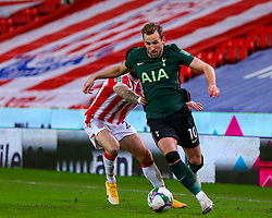 Harry Kane of Tottenham Hotspur is shackled by Steven Fletcher of Stoke City  - Mandatory by-line: Nick Browning/JMP - 23/12/2020 - FOOTBALL - Bet365 Stadium - Stoke-on-Trent, England - Stoke City v Tottenham Hotspur - Carabao Cup