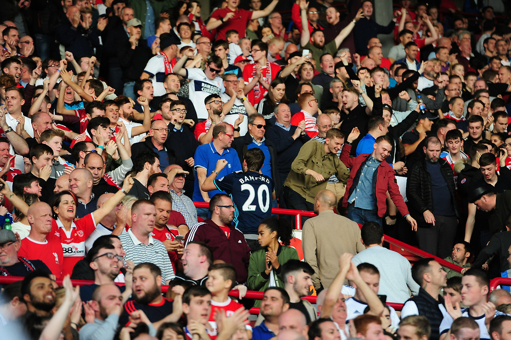 Middlesbrough fans celebrate their teams second goal, scored by Britt Assombalonga<br /> <br /> Photographer Chris Vaughan/CameraSport<br /> <br /> The EFL Sky Bet Championship - Barnsley v Middlesbrough - Saturday 14th October 2017 - Oakwell - Barnsley<br /> <br /> World Copyright © 2017 CameraSport. All rights reserved. 43 Linden Ave. Countesthorpe. Leicester. England. LE8 5PG - Tel: +44 (0) 116 277 4147 - admin@camerasport.com - www.camerasport.com