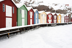 Colourful wooden cabins in Traditional fishing village of Smogen during winter after snow on Bohuslan coast in Sweden