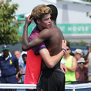 Winner Francis Tiafoe, USA, and Andrey Rublev, Russia, embrace after after his astonishing win over number one seed Andrey Rublev, Russia, in the Junior Boys' Singles Quarterfinals. Tiafoe blew a 6-1, 5-1 lead to win the third set 6-4 in sweltering heat during the US Open Tennis Tournament, Flushing, New York, USA. 5th September 2014. Photo Tim Clayton