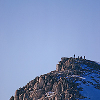 MOUNTAINEERING. Climbers atop a peak near Mount Vaughan in Trans-Antarctic Mountains, Antarctica.