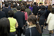 business commuters on there way home Shinjuku railway station Japan