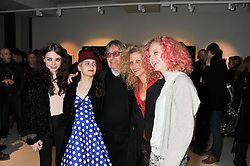 Left to right, Matilda Wyman, Katherine Wyman, Bill Wyman, Suzanne Wyman and Jessica Wyman at a private view of Bill Wyman - Reworked held at the Rook & Raven Gallery, 7 Rathbone Place, London W1 on 26th February 2013.