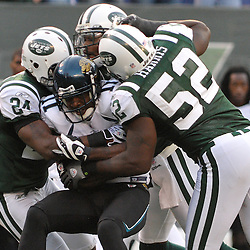Nov 15, 2009; East Rutherford, NJ, USA; New York Jets cornerback Darrelle Revis (24), safety Kerry Rhodes (25) and linebacker David Harris (52) gang tackle Jacksonville Jaguars wide receiver Mike Sims-Walker (11) during second half NFL action in the Jacksonville Jaguars 24-22 victory over the New York Jets at Giants Stadium.