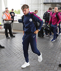 Patrick Roberts as the Manchester City team arrive at Manchester Airport as they jet for Iceland