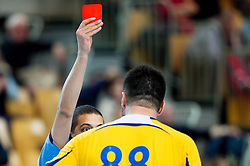 Referee Khalid Sami with red card  during handball match between RK Cimos Koper and Frisch Auf Goeppingen (GER) in 3rd Round of EHF Cup 2012/2013, on February 23, 2013 in Arena Bonifika, Koper, Slovenia. Goeppingen defeated Cimos Koper 39-36. (Photo By Vid Ponikvar / Sportida)