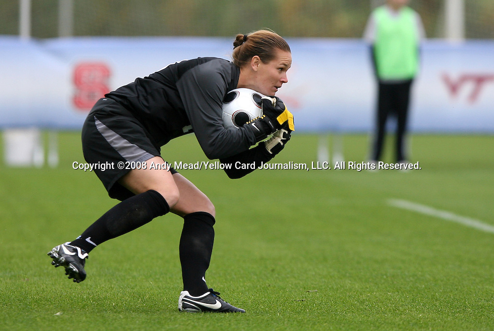 05 November 2008: North Carolina's Ashlyn Harris gathers up the ball. The University of North Carolina defeated the University of Miami 1-0 at Koka Booth Stadium at WakeMed Soccer Park in Cary, NC in a women's ACC tournament quarterfinal game.