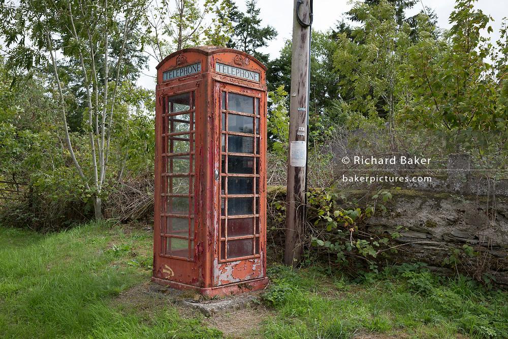 A now disused peeling old K2 telephone box kiosk, on 10th September 2018, near Lingen, Herefordshire, England UK.