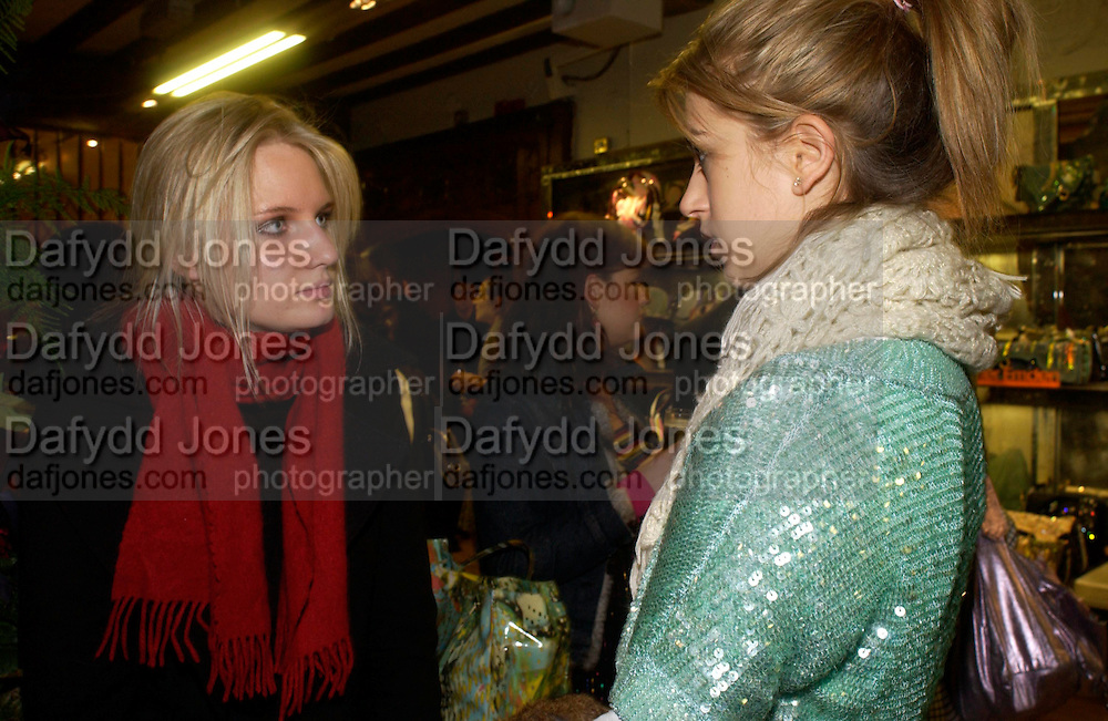 Lowell Delaney and India Standing. Party hosted by Isabella Blow in honour of Shaun Leane to celebrate his jewelry collection. Liberty's. London. 8 December 2004. ONE TIME USE ONLY - DO NOT ARCHIVE  © Copyright Photograph by Dafydd Jones 66 Stockwell Park Rd. London SW9 0DA Tel 020 7733 0108 www.dafjones.com