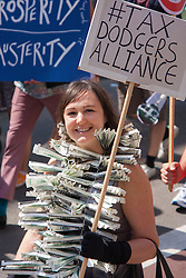 London, June 21st 2014. A young woman protests against tax dodgers as thousands march through London against government austerity measures.