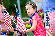 A young girl wearing patriotic costume rides her decorated bicycle during the I'On neighborhood Independence Day parade July 4, 2015 in Mt Pleasant, South Carolina.