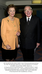 SIR ALASTAIR & LADY AIRD, he is the private secretary to HM The Queen Mother, at a reception in London on 29th November 2000.OJO 16