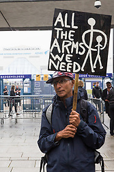 London, UK. 14th September, 2021. A Stop The Arms Fair activist protests outside the entrance to ExCeL London on the first day of the DSEI 2021 arms fair. Activists from a range of different groups have been protesting outside the venue for one of the world's largest arms fairs for over a week.